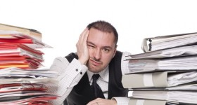 Man with to much work. Image: Gemenacom/Bigstock.com